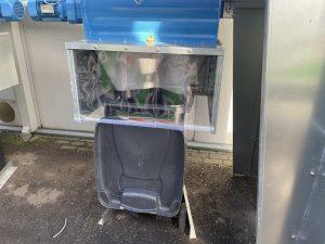 afvalcontainer onder afzuiginstallatie